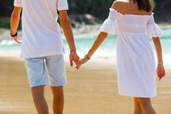 couple walking on beach together Royalty Free Stock Image