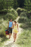 Couple Walking On Beach Trail Stock Photos
