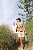 Couple Walking On Beach Trail royalty free stock photos