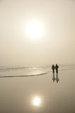 Couple walking on beach. Royalty Free Stock Photo