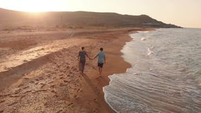 Couple walking on beach stock video footage