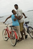Couple Walking With Bicycles On Beach Royalty Free Stock Images