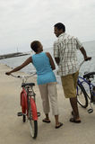 Couple Walking With Bicycles On Beach Royalty Free Stock Photo