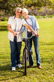 Couple walking bike Stock Photo