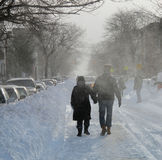 Couple walking through Blowing Snow Blizzard 2010 Royalty Free Stock Images