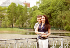 A couple walking on a bridge. In a park Stock Image