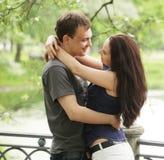 A couple walking on a bridge. In a park Royalty Free Stock Photos