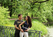 couple walking on a bridge stock photos