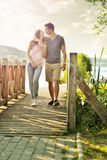 Couple walking on the bridge Royalty Free Stock Photo