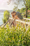 Couple walking on the bridge Stock Images