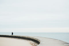 The Couple Walking on the Bridge into The Lake. Michigan in Chicago, Illinois Stock Images