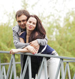 Couple walking on a bridge in a park Stock Images