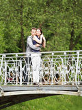 Couple walking on a bridge in park Royalty Free Stock Image