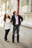 Couple walking by city Royalty Free Stock Images