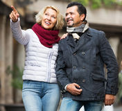 Couple walking in city Stock Photography
