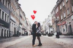 Couple Walking on City Street Stock Photos