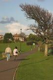 Couple walking on coastal path Stock Images