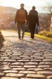 Couple walking on cobblestone foot path. In freiburg, Germany Royalty Free Stock Photos
