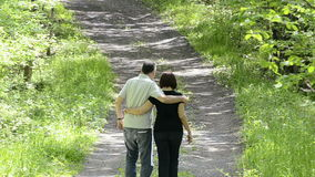 Couple walking on country road Stock Photos
