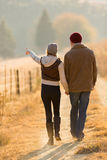 Couple walking country road Stock Photography