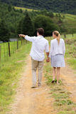 Couple walking country road Royalty Free Stock Photography