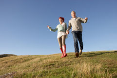 Couple walking in countryside Royalty Free Stock Images