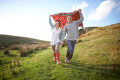 Couple walking in countryside Stock Image