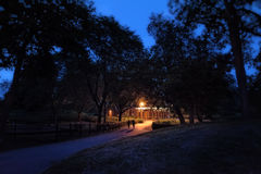 A couple walking in a dark and scary Chicago city park at night. Stock Image