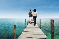 Couple walking on deck at paradise island Royalty Free Stock Photography
