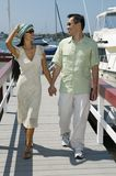 Couple walking on dock Stock Photo