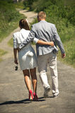 Couple walking down lane Stock Images