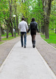 Couple walking down the road Stock Photo