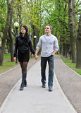 Couple walking down the road Royalty Free Stock Images