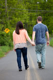 Couple Walking Down the Road Together Stock Image