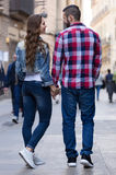 Couple walking down the street Stock Photography