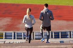 Couple walking downstairs on stadium Stock Photography
