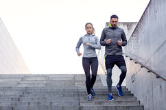 Couple walking downstairs on stadium Royalty Free Stock Image