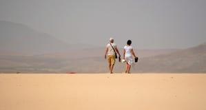 Couple walking on Dunes Royalty Free Stock Photo