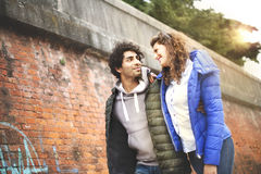 Couple walking embraced around the city Royalty Free Stock Images