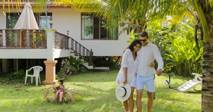 Couple Walking Embracing Outdoors Near Villa House In Tropical Garden, Happy Man And Woman Lovers On Vacation stock video