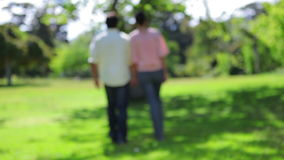 Couple walking while enjoying the nature Royalty Free Stock Image