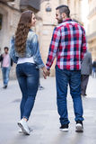 Couple walking through  European city Royalty Free Stock Images