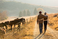 Couple walking farm road Stock Image