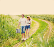 Couple walking in field Stock Photo