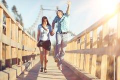 Couple walking on  footbridge Royalty Free Stock Image