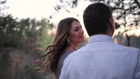 Couple walking in the forest stock video footage