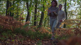 Couple walking in the forest in autumn