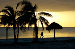 Couple walking on Fort Myers Beach. Sunset silhouette of Couple walking on Fort Myers Beach Stock Photography
