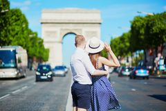 Couple walking in front of Triumphal arch in Paris. France Royalty Free Stock Image