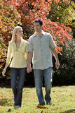 Couple walking in grass Stock Image